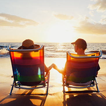 retired couple sitting in beach chairs
