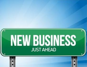 road sign that says new business