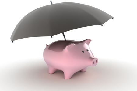 a piggy bank with an umbrella to protect from a rainy day