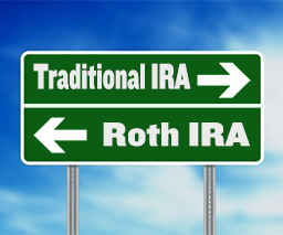 a street sign showing a fork in the road, the choices are turn left for a traditional ira and turn right for a roth ira.