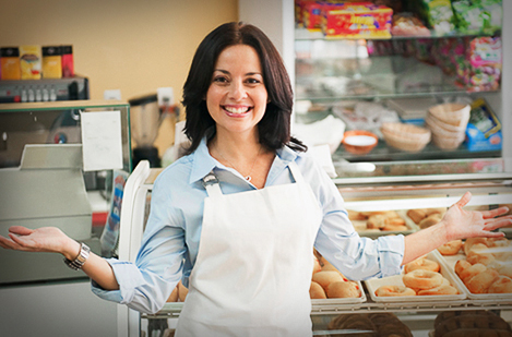 small business owner looks delighted after cutting costs and increasing profitability