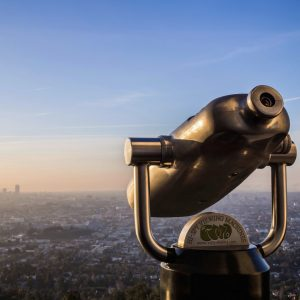 binoculars looking out over the city scape