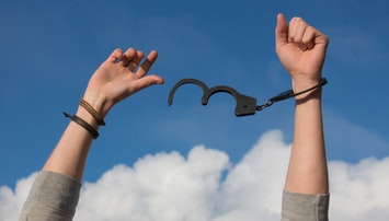 a man breaks free from handcuffs signaling freedom
