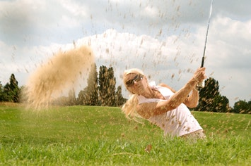 a woman playing more golf now that she is retired