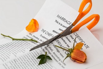 a marriage certificate being cut in half