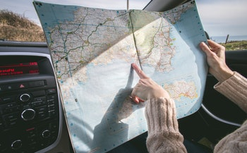 a woman examines a map